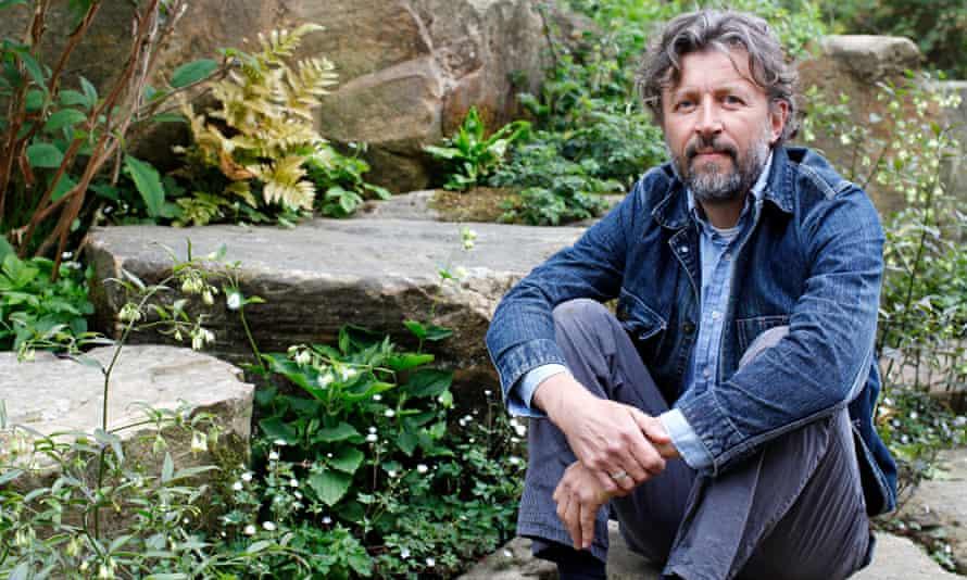 Dan Pearson sitting in his garden