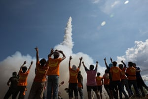 Spectators cheer as their rocket takes off