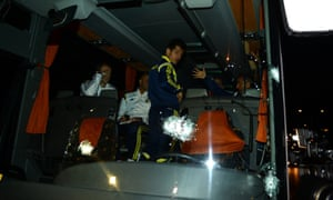 Fenerbahce's Emre Belozoglu and head coach Ismail Kartal, right, standing inside their bus after the attack  in northern Turkey last month.
