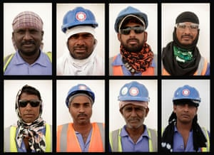Labourers pose for a portrait at a workers' camp in Doha, Qatar.