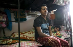 Labourers rest in a foreign workers' dormitory in Sanaya.