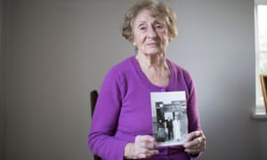 Susan Pollack holds a picture of her with her parents, who were killed in the Holocaust.