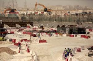 Labourers building al-Wakra stadium.