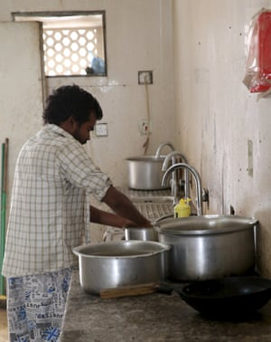 A labourer washes up in a dormitory site in the Sanaya industrial area of Doha.