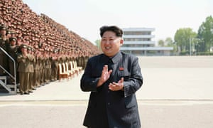 North Korean leader Kim Jong-un at a photo session with a group of training officers.