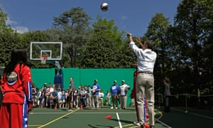President Barack Obama plays with the Harlem Globetrotters in 2012.