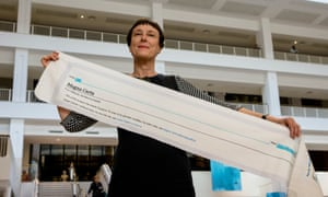 Cornelia Parker with a fragment of Magna Carta (An Embroidery).