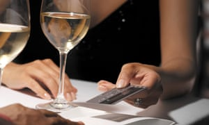 Woman paying for dinner shock