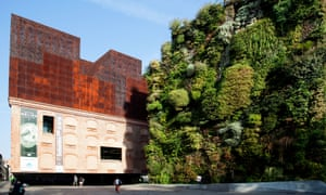 CaixaForum Museum and culture center, constructed by the Swiss architects Herzog & de Meuron next to the 'Green Wall' by PatrickMadrid