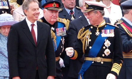 Tony Blair and Prince Charles share a joke