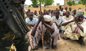 Men in the Cameroon village of Bia, which was attacked by Boko Haram