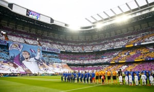 The teams line up in front of an impressive tifo courtesy of the Real Madrid fans.
