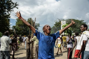 A man celebrates in Bujumbura following the radio announcement of the coup by Major General Godefroid Niyombare