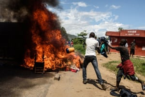 Protesters loot the local police post in Musaga, a neighbourhood of the capital, burning furniture, mattresses and clothing