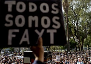 A man holds a sign that reads 'We are all Fayt' during a rally in support of the supreme court judge.