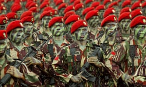 Indonesian soldiers of Special Forces Commandos march during a parade . The military is insisting all female recruits have virginity tests.
