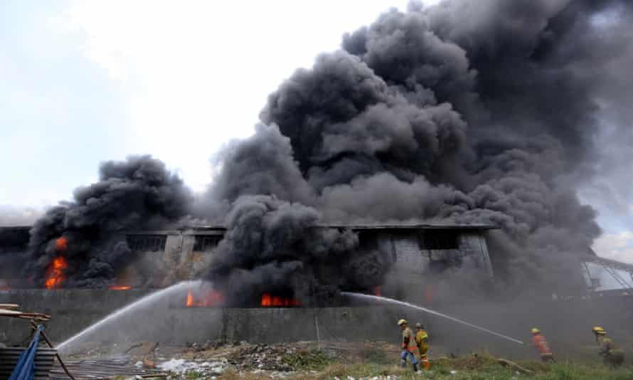 Firemen train their hoses on the burning Kentex footwear factory at Valenzuela city, a northern suburb of Manila.