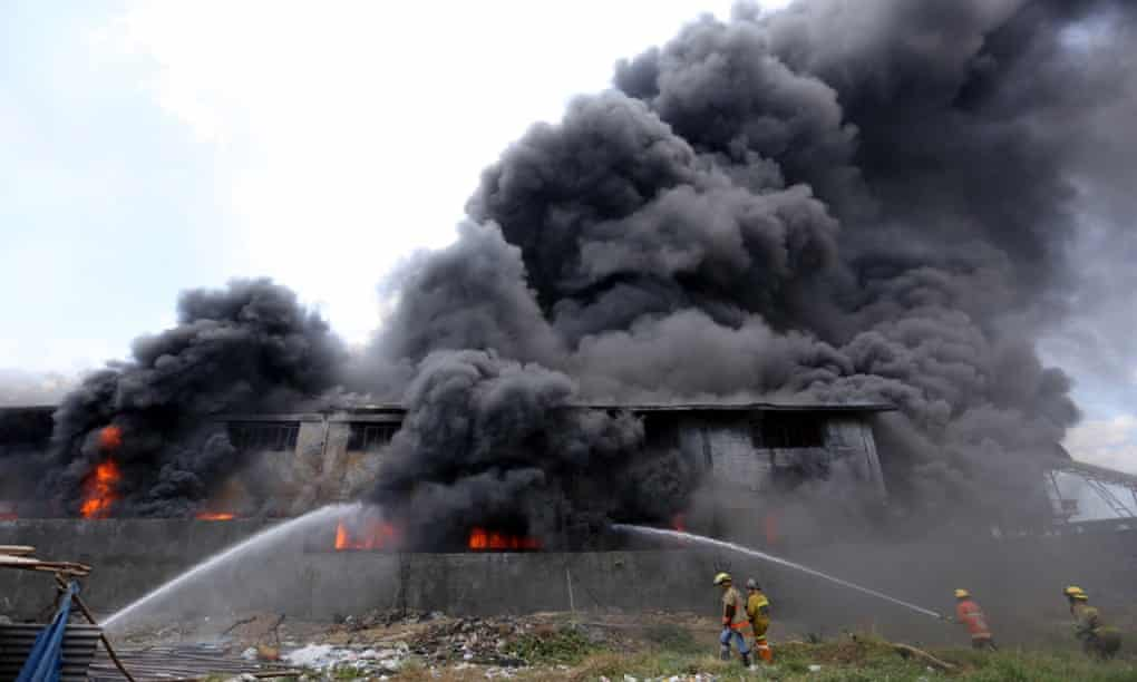 More bodies found in Philippines slipper factory fire