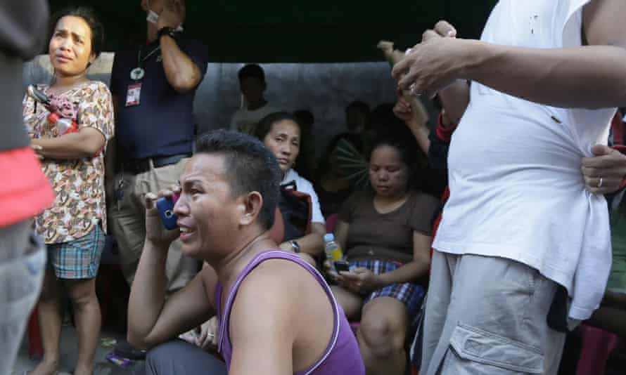 Relatives wait for news on the fate of their loved ones.