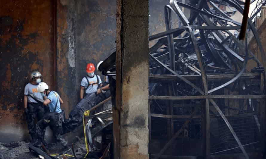 Tangled metal inside the Kentex factory as police continue to recover bodies.