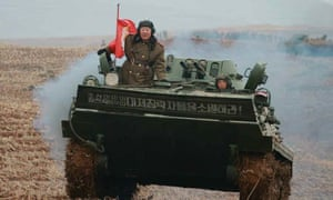 North Korean defence minister Hyon Yong-chol riding an armoured personnel carrier before his reported downfall.