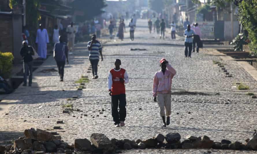 People walk in a street in Bujumbura.