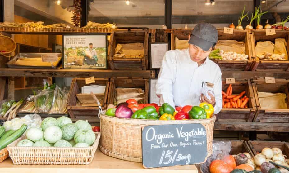 Chinese man selling organic vegetables