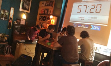 Four players (and DJ) at a Netrunner tournament in London's Loading Bar.