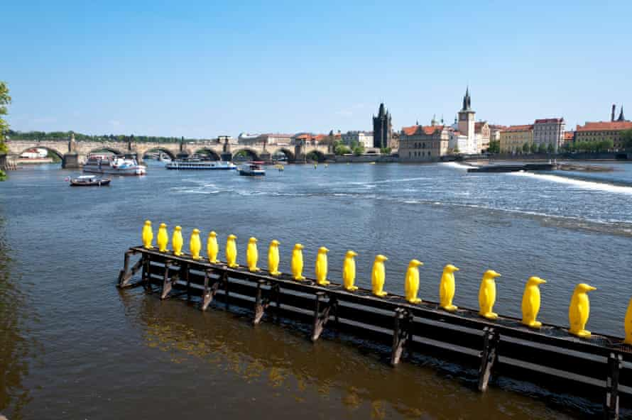 34 yellow penguins, on the Vltava River. An installation by the Cracking Art Group in collaboration with Muzeum Kampa.
