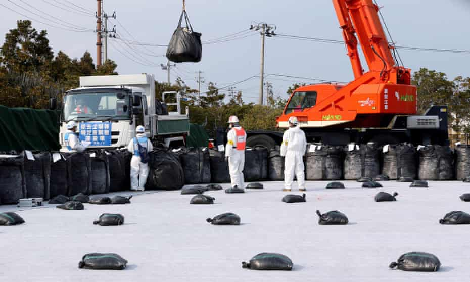 Radioactive soil and debris is arranged for storage in Fukushima, Japan.