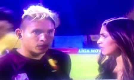 Aquiles Ocanto was giving a live TV interview when he was kicked by a fan.