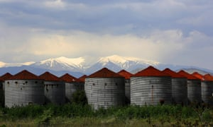 "Deserted grain silos in front of the snowcapped Mount Olympus near Larissa in Greece.<br>Yannis Behrakis has documented the ruins of Greece's industry and you can view a gallery of his work <a href=""http://www.theguardian.com/artanddesign/gallery/2015/may/15/modern-ruins-the-ghost-factories-of-greece-in-pictures"">here</a>"