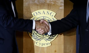 President Nicos Anastasiades, right, and the Turkish Cypriot leader, Mustafa Akinci, shake hands after a dinner inside the UN-controlled buffer zone that divides Nicosia.