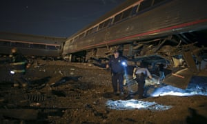 Emergency personnel work at the scene of the deadly Amtrak train derailment in Philadelphia.