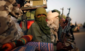 Tuareg Malian soldiers under the command of Colonel El-Hadj Ag Gamou patrol the streets of Gao, northern Mali in 2013.