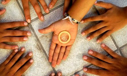 Teens holding a condom