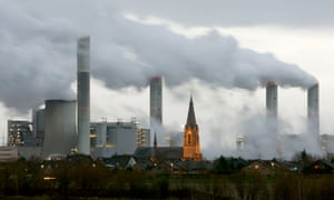The village of Gusdorf, west of Cologne in Germany, is pictured in front of the lignite-fired power plant