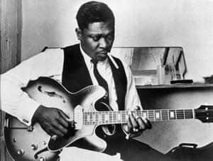 Playing guitar, 23 July 1969.