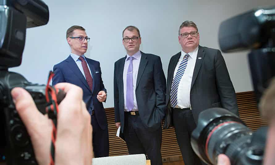 National Coalition party leader Alexander Stubb, Centre Party leader Juha Sipilä and Finns leader Timo Soini (from left to right) at a press conference.