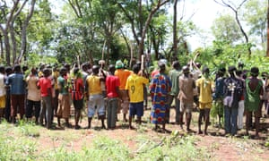 Children associated with the anti-Balaka militia gather around the militia's leaders before a release ceremony in in Bambari in the Central African Republic