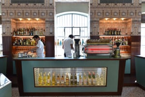Waiters at Bar Luce, designed by Wes Anderson in the style of the old Milanese cafes and located in Prada's Foundation arts venue. Foundation is located in Largo Isarco, an industrial zone in Milan