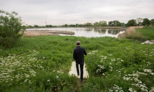 'A whole new habitat will be created – eventually, bitterns will come' ... David Mooney at Woodberry Wetlands. Photograph: Graeme Robertson for the Guardian