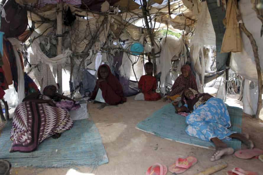 A Somali refugee family is pictured inside their makeshift shelter at the Ifo camp in Dadaab near the Kenya-Somalia border, May 8, 2015.
