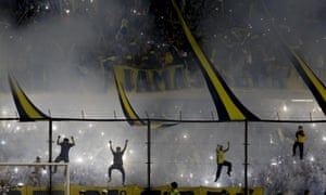 Boca Juniors football fans rally before a Copa Libertadores match against River Plate in Buenos Aires, Argentina. The game was later abandoned after Boca fans attacked opposition players with tear gas, hospitalising four.