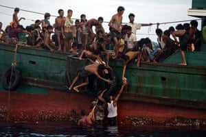 Rohingya migrants have been making the dangerous journey by sea from Burma in their thousands. Here, food supplies dropped by a Thai army helicopter are brought on board a boat drifting in Thai waters off the southern island of Koh Lipe in the Andaman sea.