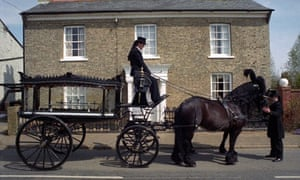 Horse drawn hearse outside a family funeral directors