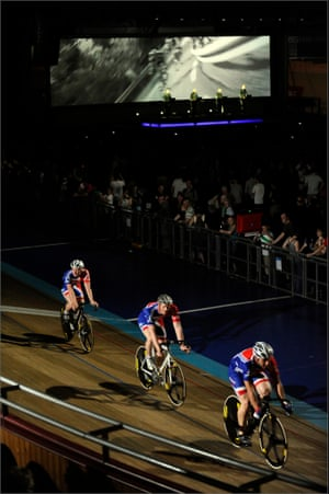 Kraftwerk performing at the Manchester Velodrome in 2009, with the help of four Olympic gold-medallists from the British cycling team.