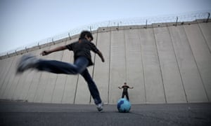 TOPSHOTS Palestinian children play footb