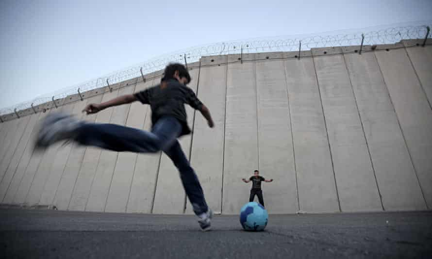 TOPSHOTS Palestinian children play footb