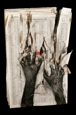 Peter Kennard's Newspaper 1 (1994). Carbon toner, oil, charcoal, pastel on newspaper.